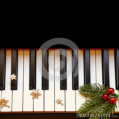 Christmas branch on piano
