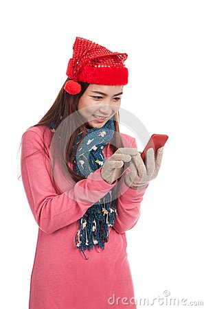 Asian girl with red christmas hat touch smart phone