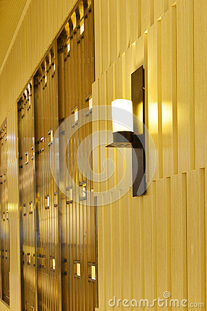 Outside commercial building at night,Wall lamp on the wooden wall,modern shop ,modern business building otside,