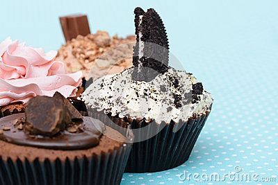 Chocolate Strawberry Cookies and cream cup cake on vintage table cloth