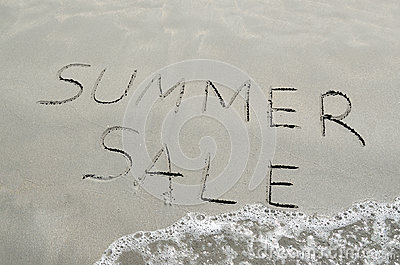 Summer sale written in the sand