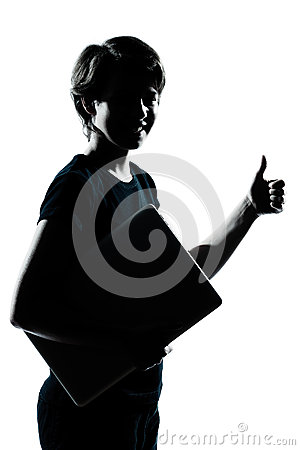 One young teenager boy girl silhouette holding carrying laptop c