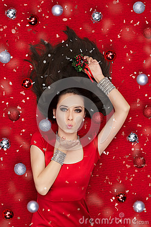 Christmas Girl Holding a Mistletoe and Blowing Kisses