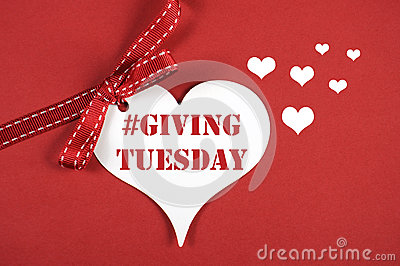 #Giving Tuesday white heart on red background.