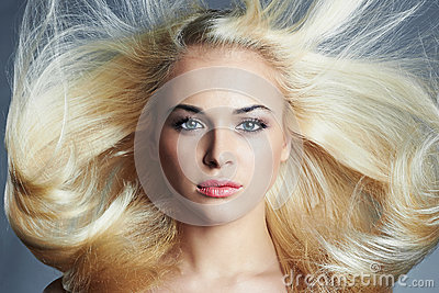 Young beautiful blond woman with long hair. pretty girl. Beauty salon haircare