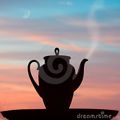 Silhuette teapot in the sunrise