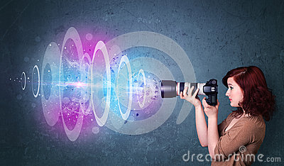 Photographer girl making photos with powerful light beam