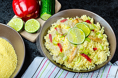 Couscous with grilled chicken meat and vegetables