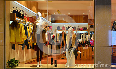 Fashion boutique display window with mannequins, go shopping, dress shop window