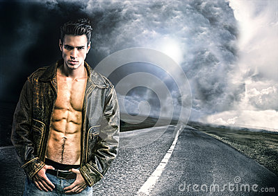 Young man walking down a road with very bad weather far away
