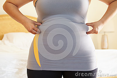 Close Up Of Overweight Woman Squeezing Waistline