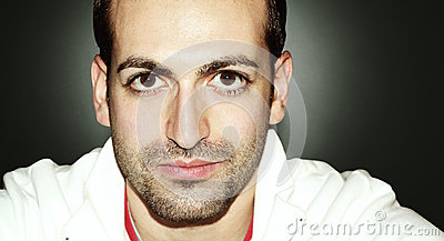 Man with big eyes and beard. Horizontal portrait. On grandient background