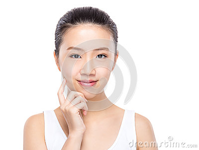 Asian woman with finger touch on face