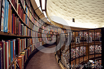 Beautiful city library with rows of books in several levels.