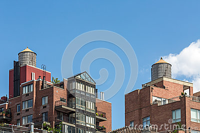 Modern Condo Buildings with water tank on top, New York City, USA