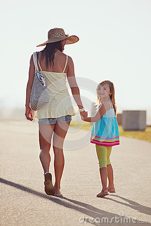 Mother daughter holding hands