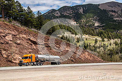 Diesel semi trailer truck on highway in rocky mountains