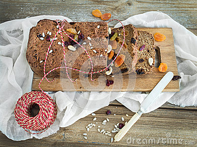 Home-made whole grain Christmas bread with dried fruit, seeds an