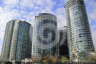 Modern, Contemporary Glass Luxury Condo High Rise Buildings. New Construction
