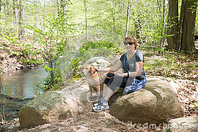 Mature Woman outdoors with dog