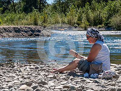 Mature Woman outdoors on river bank