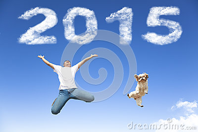 Happy new year 2015.young man and dog jumping