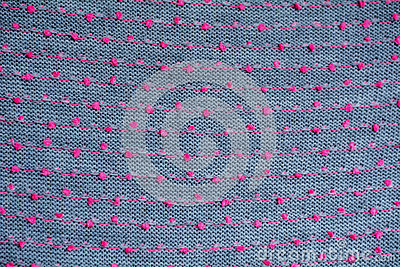 Knitted fabric gray background close up