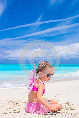 Adorable little girl with wings like butterfly on