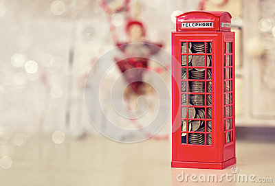 London telephone booth moneybox on wooden white table