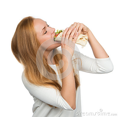 Woman eating tasty unhealthy twister sandwich in hands hungry