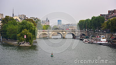 View of Pont Neuf arched stone bridge in Paris