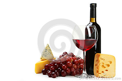 Glass of red wine, cheeses and grapes isolated on a white