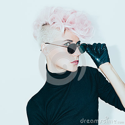 Blond model in vintage glasses with stylish haircut. fashion pho