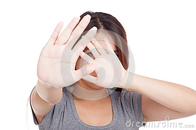 Young Asian woman hide her face with hand