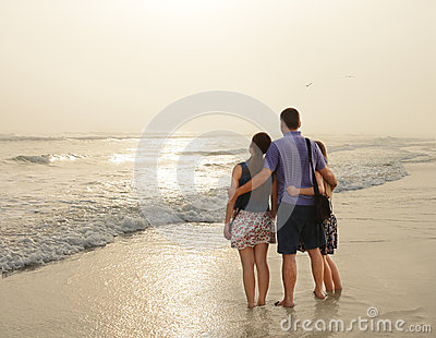 Family enjoying time together on beautiful foggy beach.