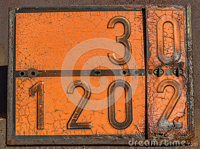 Old and rusty orange plate with hazard identification number
