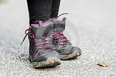 Sneakers Standing on the road .mountain shoes