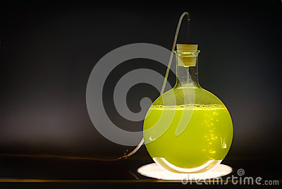 Volumetric flask with green liquid chemical experiment