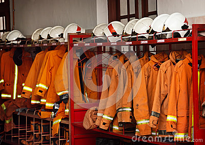 Firefighting Equipment Arranged on Racks at the Fire Station