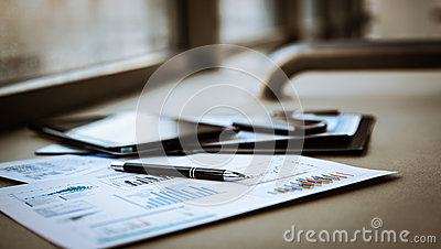 Business documents with charts growth