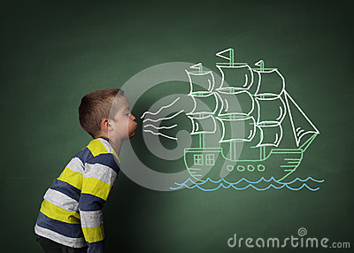 Child blowing a chalk sailboat