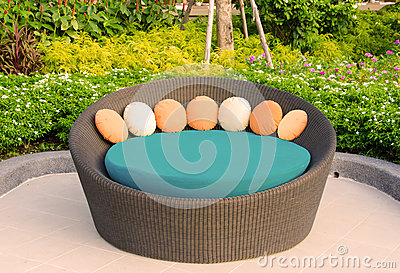 Rattan armchair furniture in garden