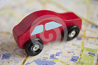 Red Wooden Toy Car On Road Map