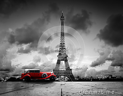 Effel Tower, Paris, France and retro red car.