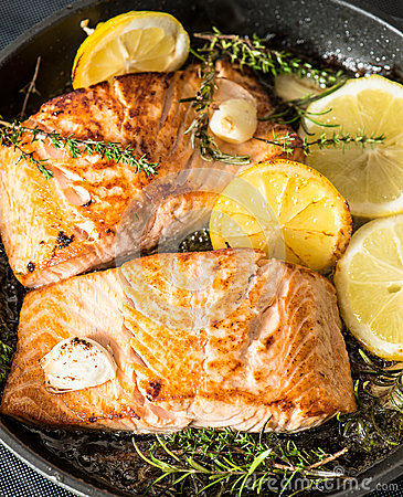 Grilled salmon with herbs, garlic and lemon. FIsh food