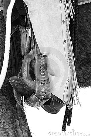 Black and white photograph of cowboy boots and spurs