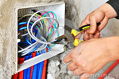Electrician installing a switch socket