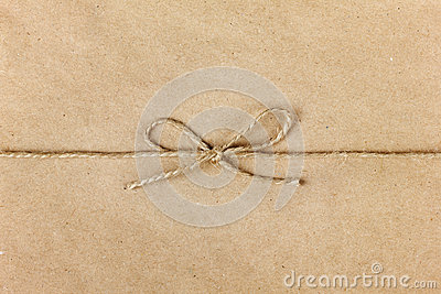 String or twine tied in a bow on kraft paper