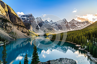 Scenic view of Moraine lake and mountain range at sunset