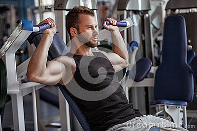 stock image of young man in sport gym club